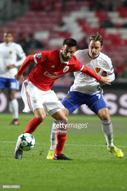 Benfica's Greek midfielder Andreas Samaris fights for the ball with Basel's midfielder Luca Zuffi from Suisse during the UEFA Champions League Group...