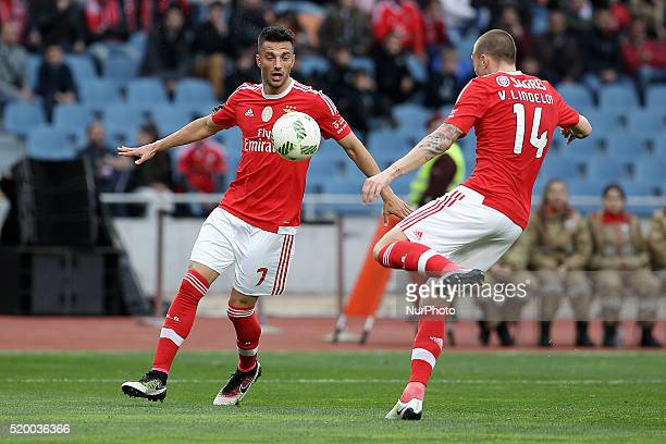 Benfica's Greek midfielder Andreas Samaris in action with Benfica's Swedish defender Victor Lindelöf during the Premier League match between...