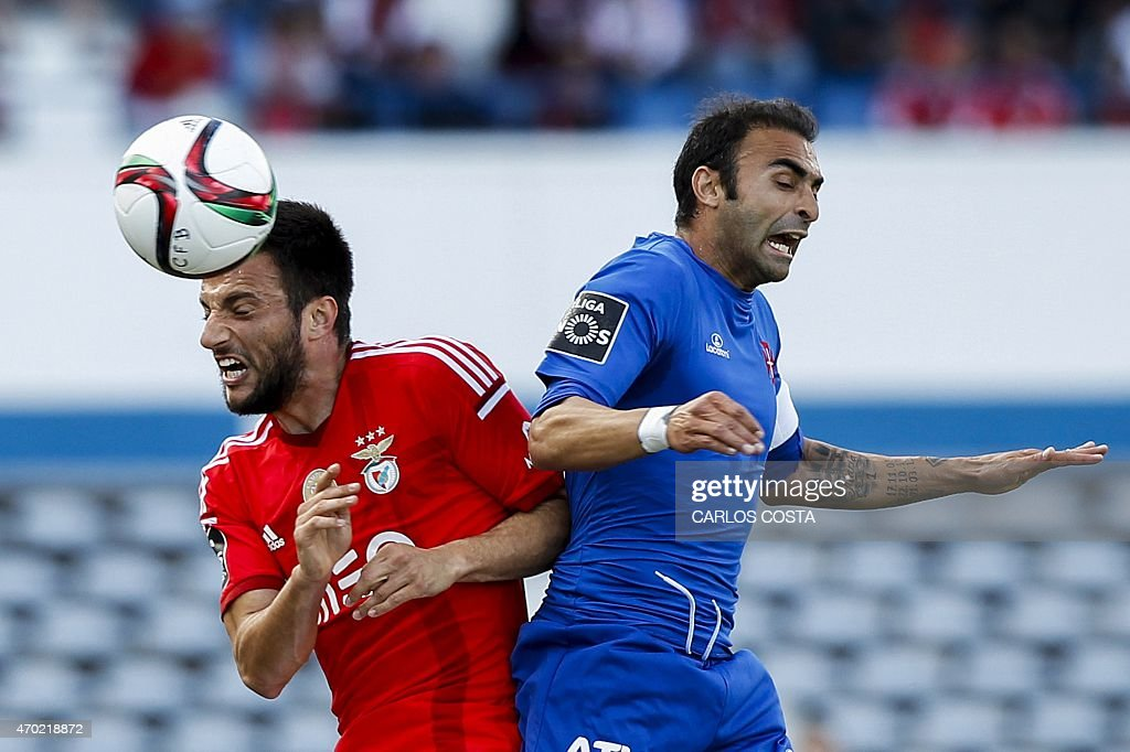 Benfica's Greek midfielder Andreas Samaris (L) vies with Belenenses's midfielder Carlos Martins (R) during the Portuguese league football match CF Os Belenenses v SL Benfica at the Restelo stadium in Lisbon on April 18, 2015.