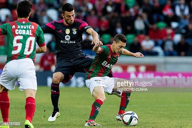 Benfica's Greek midfielder Andreas Samaris vies with Maritimo's midfielder Alex Soares during the Portuguese league football match CS Maritimo vs SL...