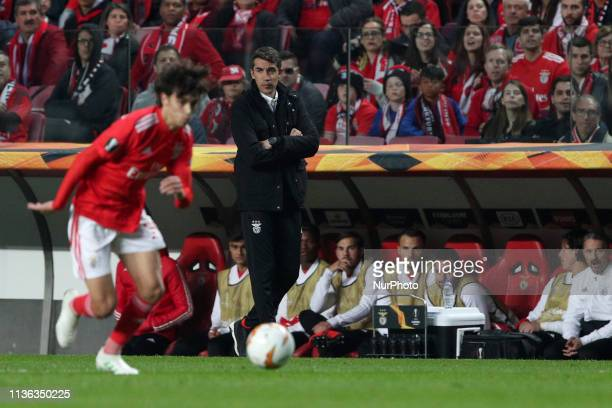 Benfica's head coach Bruno Lage looks to Benfica's Portuguese forward Joao Felix during the UEFA Europa League QuarterFinals 1st Leg football match...
