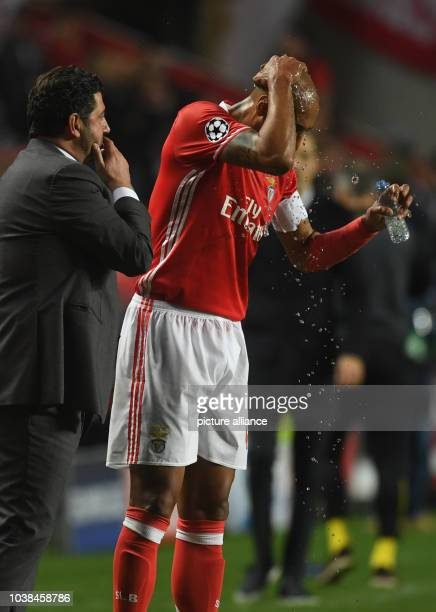 Benfica's Lusiao refreshes himself during a pause at the Champions League round of sixteen soccer match between Benfica Lissabon and Borussia...