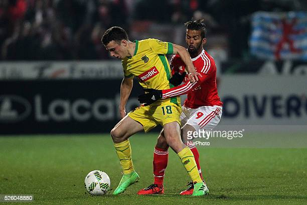 Benfica's Marooc midfielder Mehdi Carcela vies with Pacos Ferreira's Portuguese midfielder Diogo Jota during the Premier League match between Pacos...