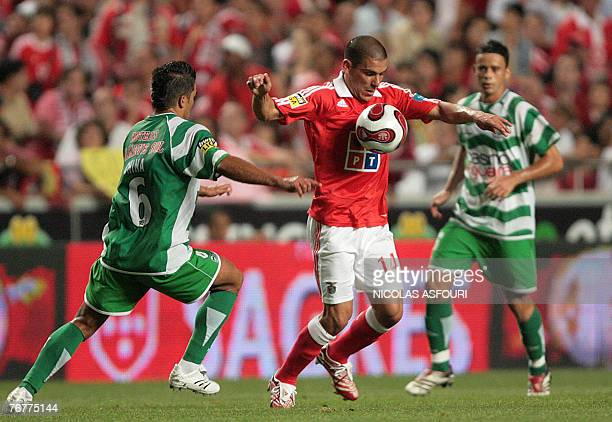 Benfica's Maxi Pereira vies with Naval's China during their Premier League football match at Luz Stadium in Lisbon 15 September 2007 Naval plays...
