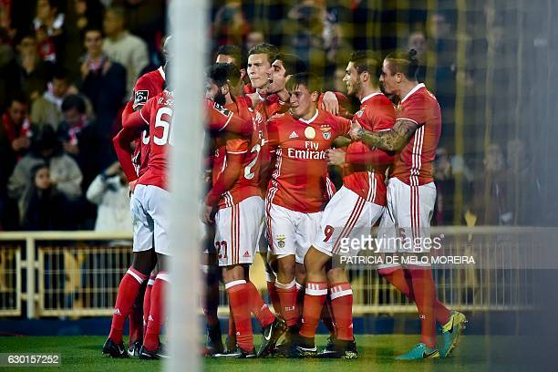 Benfica's Mexican forward Raul Jimenez celebrates a goal with teammates during the Portuguese league football match GD Estoril Praia vs SL Benfica at...