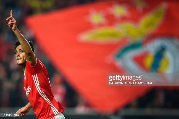 Benfica's Mexican forward Raul Jimenez celebrates after scoring during the UEFA Champions League Group B football match SL Benfica vs SSC Napoli at...