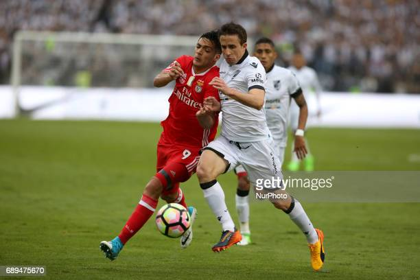 Benfica's Mexican forward Raul Jimenez fights for the ball with Vitoria Guimaraes' Brazilian midfielder Rafael Miranda during the Portugal Cup Final...