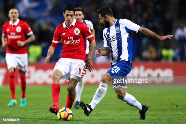 Benfica's Mexican forward Raul Jimenez in action with Porto's Brazilian defender Felipe during the Premier League 2016/17 match between FC Porto and...