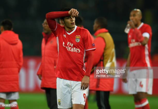 Benfica's Mexican forward Raul Jimenez reacts after the UEFA Champions League Round of 16 2ndleg football match Borussia Dortmund v SL Benfica in...