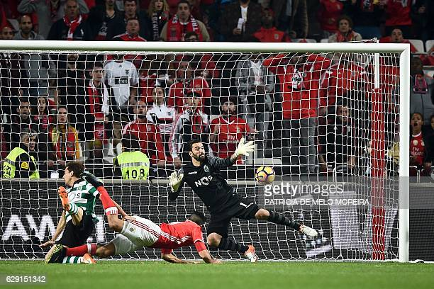 Benfica's Mexican forward Raul Jimenez scores a goal to Sporting's goalkeeper Rui Patricio during the Portuguese league football match SL Benfica vs...