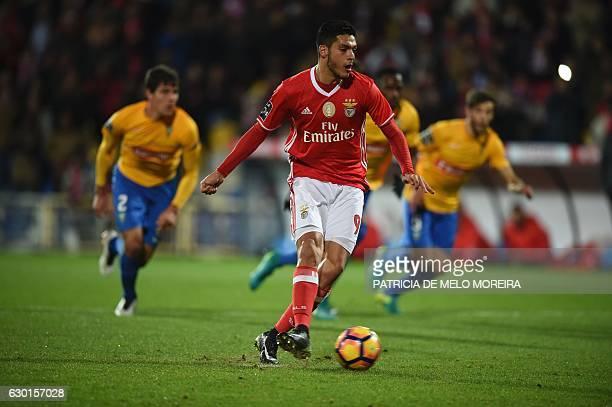 Benfica's Mexican forward Raul Jimenez shoots a penalty kick to score a goal during the Portuguese league football match GD Estoril Praia vs SL...