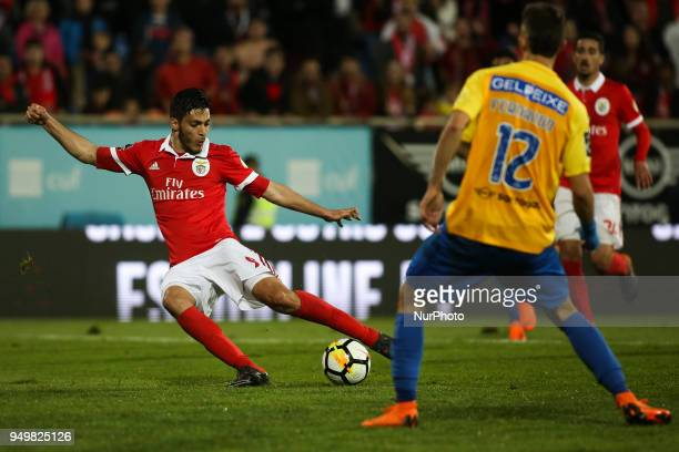 Benfica's Mexican forward Raul Jimenez shoots the ball during the Portuguese League football match between Estoril Praia and SL Benfica at Antonio...
