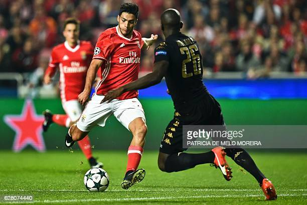 Benfica's Mexican forward Raul Jimenez vies with Napoli's Senegalese defender Kalidou Koulibaly during the UEFA Champions League Group B football...