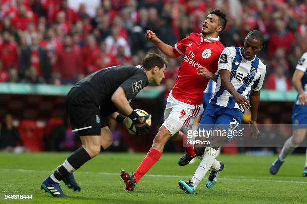 Benfica's Mexican forward Raul Jimenez vies with Porto's Spanish goalkeeper Iker Casillas and Porto's Portuguese defender Ricardo Pereira during the...