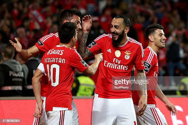 Benfica's midfielder Andreas Samaris celebrates the goal with teammates after scoring during the Portuguese League football match SL Benfica v SC...