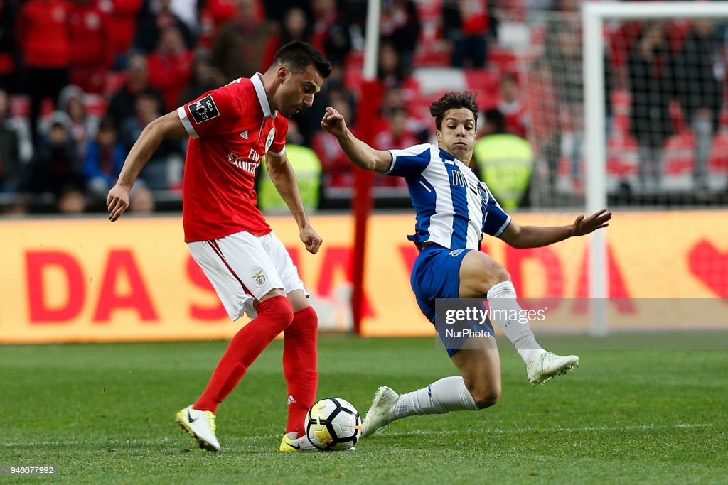 Benfica's midfielder Andreas Samaris (L) vies for the ball with Porto's midfielder Oliver Torres (R) during Primeira Liga 2017/18 match between SL Benfica vs FC Porto, in Lisbon, on April 15, 2018.