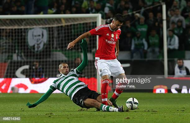 Benfica's midfielder Andreas Samaris with Sporting CP's forward Islam Slimani in action during the Taca de Portugal match between Sporting CP and SL...