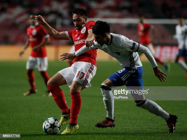 Benfica's midfielder Andrija Zivkovic vies for the ball with Basel's defender Raoul Petretta during Champions League 2017/18 match between SL Benfica...