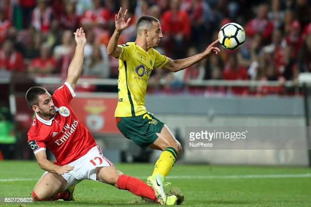 Benfica's midfielder Andrija Zivkovic vies with Pacos Ferreira's midfielder Alonso during the Portuguese League football match between SL Benfica and...
