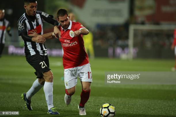 Benfica's midfielder Andrija Zivkovic vies with Portimonense's goalkeeper Carlos Henriques during the Portuguese League football match between...