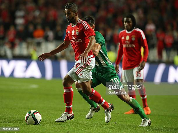 Benfica's midfielder Carcela with Rio Ave FC's midfielder Pedro Moreira in action during the Primeira Liga match between SL Benfica and Rio Ave FC at...