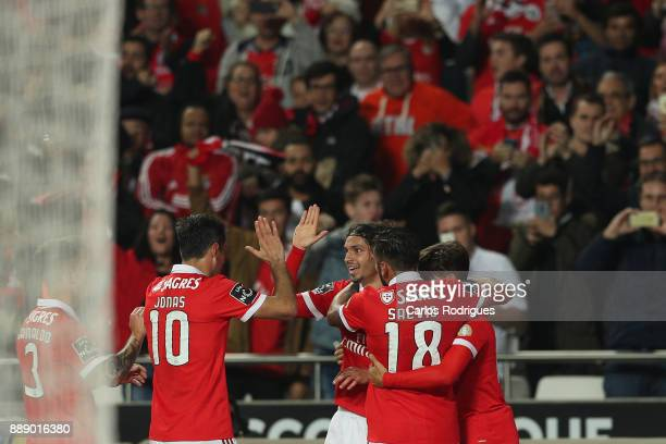 Benfica's midfielder Filip Krovinovic from Croatia celebrates scoring Benfica third goal with team mates during the match between SL Benfica and...