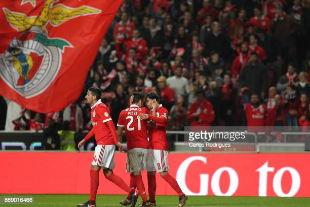 Benfica's midfielder Filip Krovinovic from Croatia celebrates scoring Benfica third goal with his team mate during the match between SL Benfica and...