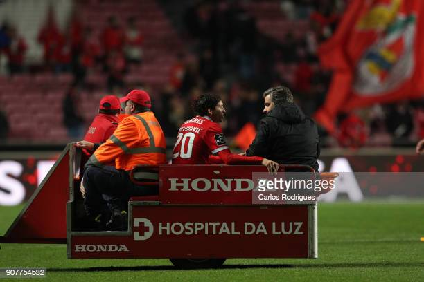 Benfica's midfielder Filip Krovinovic from Croatia leaves the pitch injured during the match between SL Benfica and GD Chaves for the Portuguese...