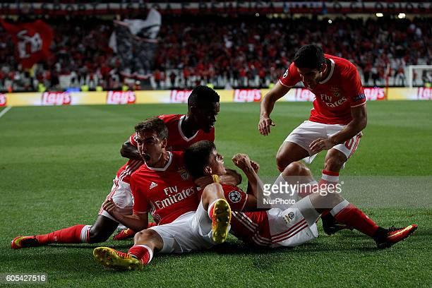 Benfica's midfielder Franco Cervi celebrates his goal with Benfica's defender Nelson Semedo Benfica's midfielder Andre Horta and Benfica's forward...