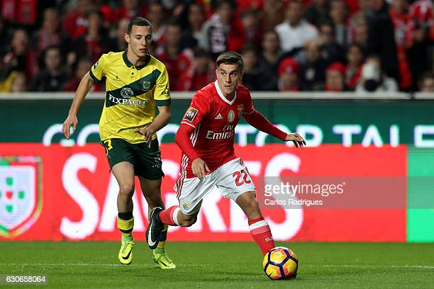 Benfica's midfielder Franco Cervi from Argentina tries to escape Pacos Ferreira's defender Francisco Afonso from Portugal during the SL Benfica v FC...