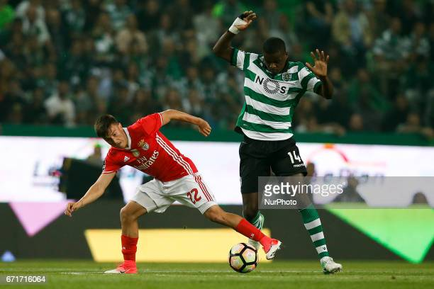 Benfica's midfielder Franco Cervi vies for the ball with Sporting's midfielder William Carvalho during Premier League 2016/17 match between Sporting...