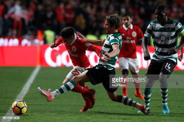 Benfica's midfielder Franco Cervi vies for the ball with Sporting's defender Fabio Coentrao during Primeira Liga 2017/18 match between SL Benfica vs...