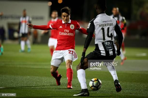 Benfica's midfielder Franco Cervi vies with Portimonense's midfielder Emmanuel Hackman during the Portuguese League football match between...