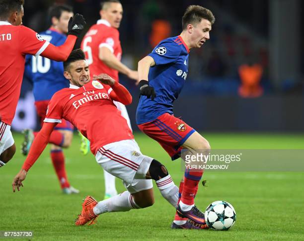 Benfica's midfielder from Argentina Eduardo Salvio and CSKA Moscow's midfielder from Russia Aleksandr Golovin vie for the ball during the UEFA...