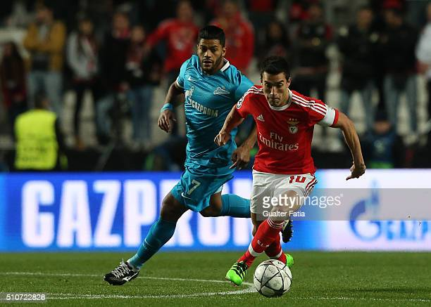BenficaÕs midfielder from Argentina Nico Gaitan with FC ZenitÕs forward Hulk in action during the UEFA Champions League Round of 16 First Leg match...