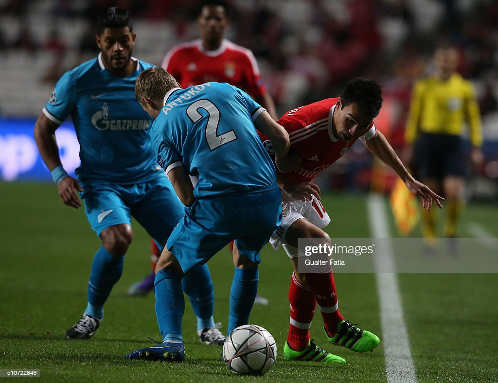 SL BenficaÕs midfielder from Argentina Nico Gaitan with FC ZenitÕs defender Aleksandr Anyukov in action during the UEFA Champions League Round of 16: First Leg match between SL Benfica and FC Zenit at Estadio da Luz on February 16, 2016 in Lisbon, Portugal.
