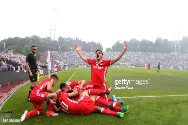 Benfica's midfielder from Argentina Salvio celebrates celebrates with teammates after scoring a goal during the Portuguese Cup Final match between SL...