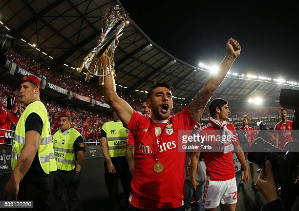 Benfica's midfielder from Argentina Salvio celebrates with trophy after winning the Portuguese League Cup Title at the end of the Taca CTT Final...
