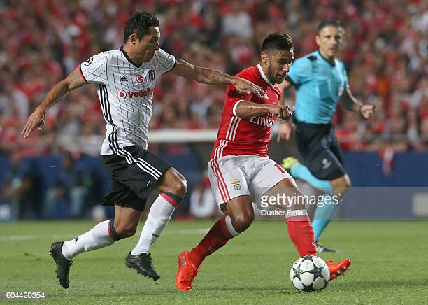 Benfica's midfielder from Argentina Salvio with Besiktas JK's defender Adriano in action during the UEFA Champions League match between SL Benfica...
