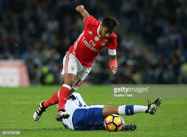 Benfica's midfielder from Argentina Salvio with FC Porto's midfielder from Spain Oliver Torres in action during the Primeira Liga match between FC...