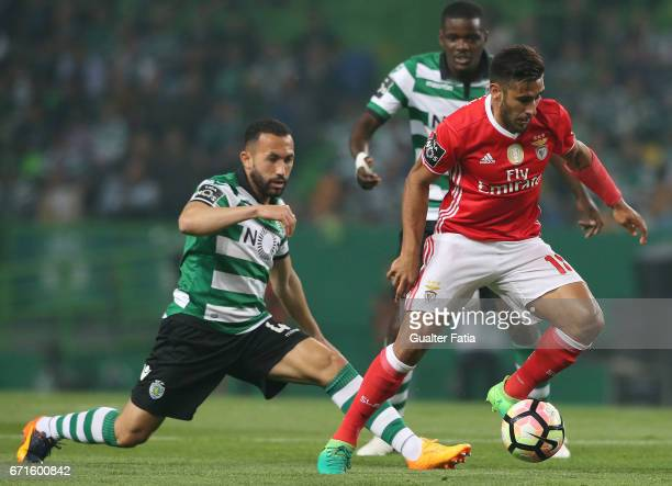 Benfica's midfielder from Argentina Salvio with Sporting CP's defender Jefferson from Brazil in action during the Primeira Liga match between...