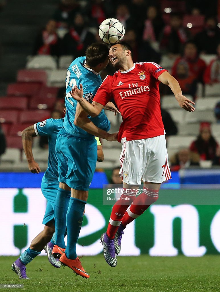 SL BenficaÕs midfielder from Greece Andreas Samaris with FC ZenitÕs forward Artem Dzyuba in action during the UEFA Champions League Round of 16: First Leg match between SL Benfica and FC Zenit at Estadio da Luz on February 16, 2016 in Lisbon, Portugal.