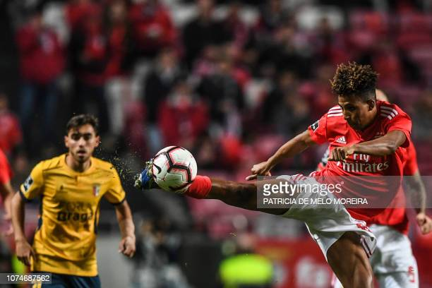 Benfica's midfielder Gedson Fernandes kicks the ball during the Portuguese League football match between SL Benfica and Sporting CP at the Luz...