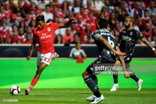 Benfica's midfielder Gedson Fernandes vies with Guimaraes' midfielder Andre Andre and Guimaraes' defender Joao Afonso during the Portuguese league...
