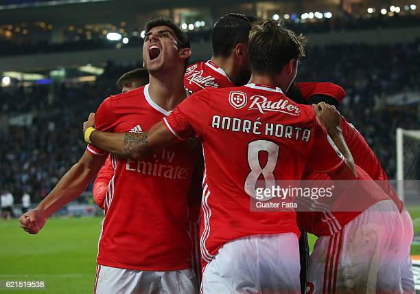 Benfica's midfielder Goncalo Guedes and teammates celebrate after SL Benfica's defender from Argentina Lisandro Lopez scored a goal during the...