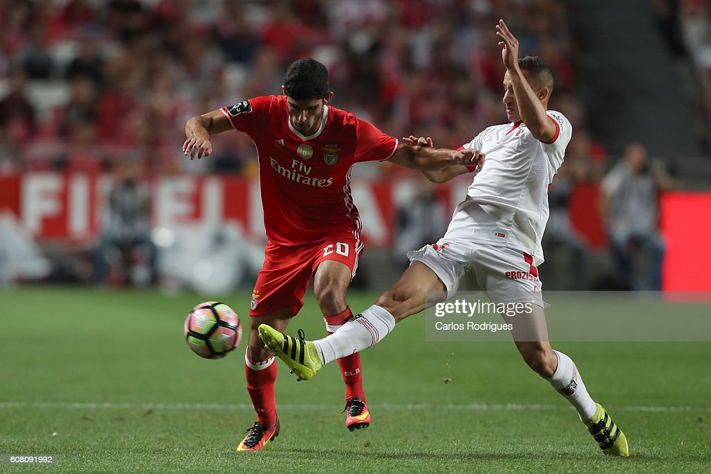 SL Benfica's midfielder Goncalo Guedes (L) vies with Braga's midfielder Mauro from Brazil (R) for the ball possession during the match between SL Benfica and SC Braga for the Portuguese Primeira Liga at Estadio da Luz on September 19, 2016 in Lisbon, Portugal.