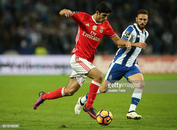 Benfica's midfielder Goncalo Guedes with FC Porto's defender from Mexico Miguel Layun in action during the Primeira Liga match between FC Porto and...