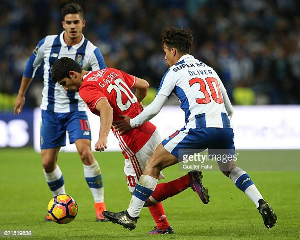 Benfica's midfielder Goncalo Guedes with FC Porto's midfielder from Spain Oliver Torres in action during the Primeira Liga match between FC Porto and...