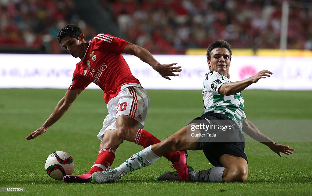 SL Benfica's midfielder Goncalo Guedes with Moreirense FC's midfielder Joao Palhinha in action during the Primeira Liga match between SL Benfica and Moreirense FC at Estadio da Luz on August 29, 2015 in Lisbon, Portugal.