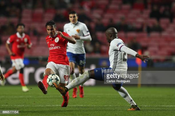 Benfica's midfielder Joao Carvalho from Portugal vies with Fc Basel defender Eder Balanta from Colombia for the ball possession during SL Benfica v...